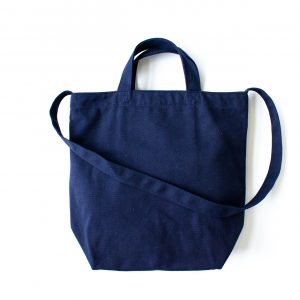 canvas sling bag with short handle